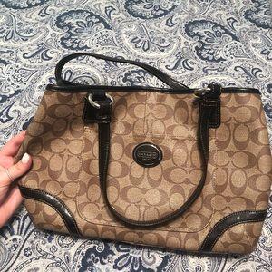 Brown Coach logo handbag